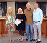 Bobbie Schaffer Orten receives #LionChaser Award at board meeting.