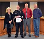 SRO Hollis Crowley receives award in boardroom