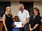 Ka'Marion Turner with Superintendent Ashby, board President J.W. Durst, and Shannon Bowles.