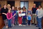 Girl Scout troop and leaders receive Game Changers certificate from Superintendent and Board of Education