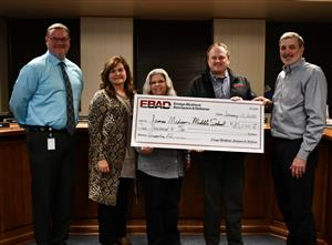 Three Ensign-Bickford reps present check to James Madison principal and teacher.