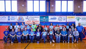 Staff members wear blue in support of Autism Awareness.