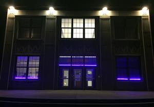 Browning Springs has blue lights shining on the outside of the school.