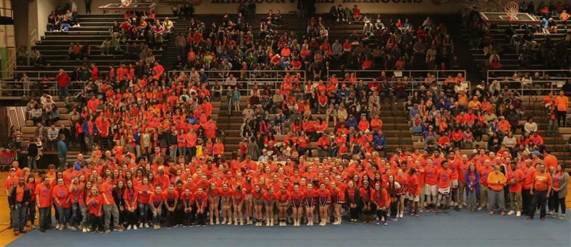 Group photo of students from both high schools wearing orange in support of Marshall County