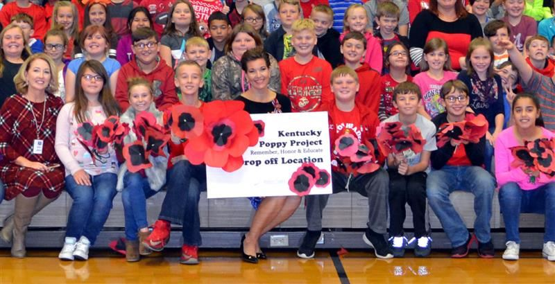 Heather French Henry and Southside students with the Poppy Project sign.