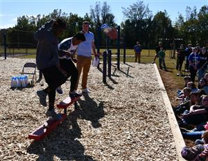 Students use step equipment.
